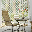 Rocking chair and little table on the veranda — Stock Photo