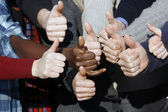 Multiracial thumbs up — Stock Photo