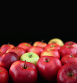 Apples on black background — Stockfoto