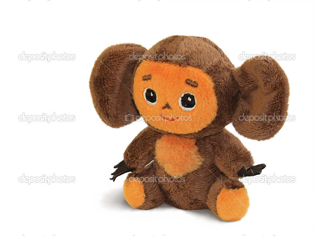 Soft toy Cheburashka sitting on a white background — Stock Photo #4421386