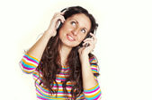 Closeup portrait of a young woman listening to music — Stock Photo