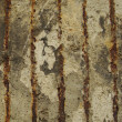 Rusty metal embedded in a worn dirty concrete wall — Stock Photo