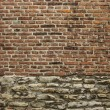 Stock Photo: Very old brick and worn stone wall