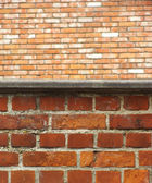 Close view of a brick wall with another brick wall in the distan — Stock Photo
