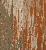 Cement and stucco dirt grunge on the side of an orange steel met — Stock Photo