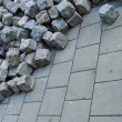 Large stack of cobbles laying on pavement and sidewalk — Stock Photo