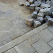 Stack of cobbles laying on pavement and sidewalk — Stock Photo #4048045