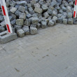 Large stack of cobbles laying on pavement — Stock Photo #4048063