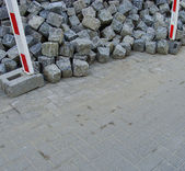 Large stack of cobbles laying on pavement — Stock Photo