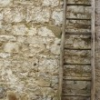 Stock Photo: Vintage wooden ladder in front of old stone wall