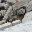 Stock Photo: Large stacked broken chunks of fortified concrete