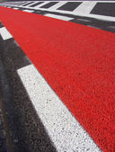 Freshly laid asphalt road with red bicycle path freshly spray pa — Stock Photo
