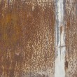 Stock Photo: Orange brown rusty metal surface with white line running verti