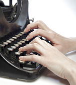 Hands typing on an old style typewriter. — Stock Photo