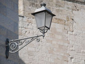 Closeup of old style street-lamp on a wall. — Stock Photo