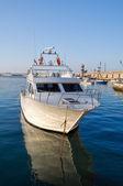 Boat moored at Monopoli port. Apulia. — Stock Photo