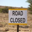 Road closed signboard in the Kalahari desert — Stock Photo