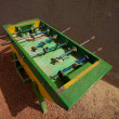 Stock Photo: Green Foosball in street