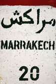 Sign road with Marrakech distance in km — Stock Photo