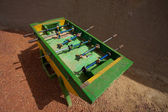 Green Foosball in the street — Stock Photo