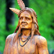 Statue Indian in wood - Stock Photo