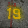 Number nineteen painted — Stock Photo