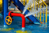 Red iron tube in pool — Stock Photo