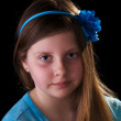 Young girl in blue with flower in her hair — Stock Photo #5215790