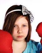 Young girl wearing boxing gloves — Stock Photo