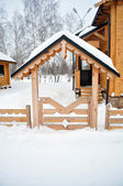 Home entrance with a wooden fence, Cabin log — Stock Photo