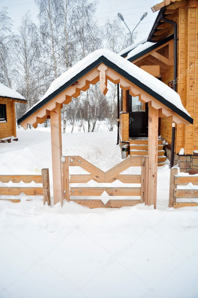 Front door to the cottage, winter chalet or a suburban house covered with snow, residential structure, building exterior, non-urban scene, residential districts — Stock Photo #4722204