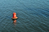 Buoy on the water surface for safe navigation — Stock Photo