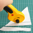 Cutting fabric with rotary cutter — Stock Photo