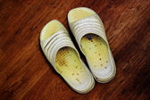 Ten year old slippers — Stock Photo
