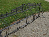 Fragment of metal rack for bicycles — Stock Photo
