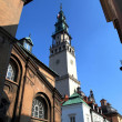 Tower among other buildings in the monastery of Jasna Gora — Stock Photo