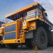 Big yellow mining truck - Stock Photo