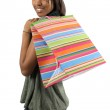Happy shopper with colorful bag — Stock Photo