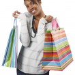 Happy shopper with colorful bags — Stock Photo