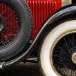 Stock Photo: Antique car fender and wheels