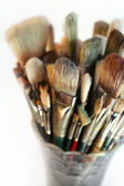 Vase of used brushes — Stock Photo
