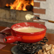 Stock Photo: Swiss fondue dinner