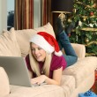 Christmas shopping at home — Stock Photo