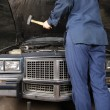 Stock Photo: Engine repair with hammer