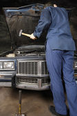 Engine repair with hammer — Stock Photo
