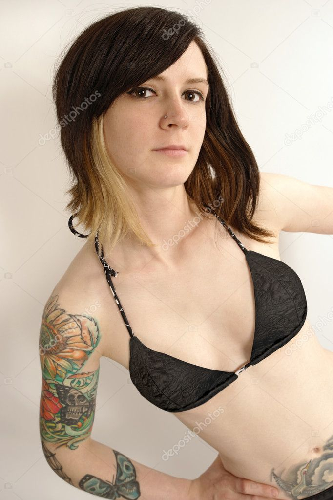 Cute young female looking into