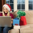 Surfing for Christmas gifts — Stock Photo