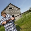 Stock Photo: Woman with huge rifle