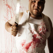 Crazy butcher with large knife — Stock Photo