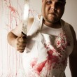 Stock Photo: Crazy butcher with large knife